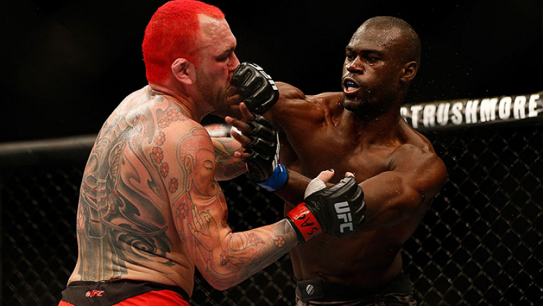 LAS VEGAS, NV - DECEMBER 28:  (R-L) Uriah Hall punches Chris Leben in their middleweight bout during the UFC 168 event at the MGM Grand Garden Arena on December 28, 2013 in Las Vegas, Nevada. (Photo by Josh Hedges/Zuffa LLC/Zuffa LLC via Getty Images) ***