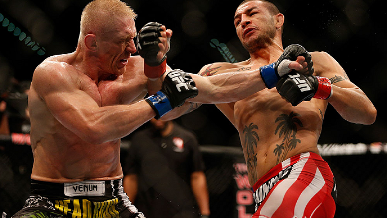LAS VEGAS, NV - JULY 06:  (R-L) Cub Swanson punches Dennis Siver in their featherweight fight during the UFC 162 event inside the MGM Grand Garden Arena on July 6, 2013 in Las Vegas, Nevada.  (Photo by Josh Hedges/Zuffa LLC/Zuffa LLC via Getty Images) ***