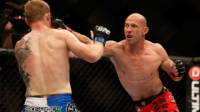 LAS VEGAS, NV - NOVEMBER 16:  (R-L) Donald Cerrone punches Evan Dunham in their lightweight bout during the UFC 167 event inside the MGM Grand Garden Arena on November 16, 2013 in Las Vegas, Nevada. (Photo by Josh Hedges/Zuffa LLC/Zuffa LLC via Getty Imag
