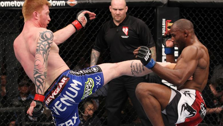 LAS VEGAS, NV - FEBRUARY 04:  Ed Herman (left) kicks Clifford Starks during the UFC 143 event at Mandalay Bay Events Center on February 4, 2012 in Las Vegas, Nevada.  (Photo by Nick Laham/Zuffa LLC/Zuffa LLC via Getty Images) *** Local Caption *** Ed Herm