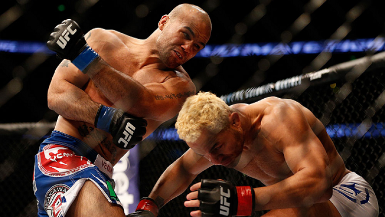 ANAHEIM, CA - FEBRUARY 23:  (L-R) Robbie Lawler punches Josh Koscheck in their welterweight bout during UFC 157 at Honda Center on February 23, 2013 in Anaheim, California.  (Photo by Josh Hedges/Zuffa LLC/Zuffa LLC via Getty Images) *** Local Caption ***