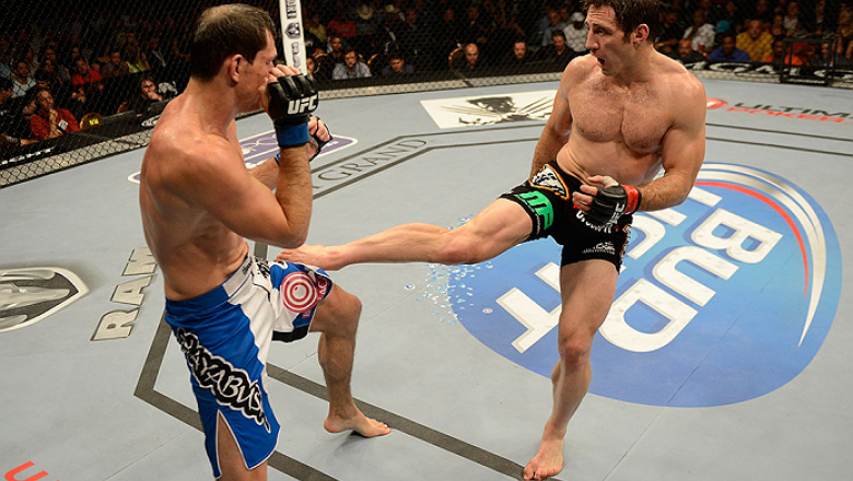 LAS VEGAS, NV - JULY 06:  (R-L) Tim Kennedy kicks Roger Gracie in their middleweight fight during the UFC 162 event inside the MGM Grand Garden Arena on July 6, 2013 in Las Vegas, Nevada.  (Photo by Donald Miralle/Zuffa LLC/Zuffa LLC via Getty Images) ***