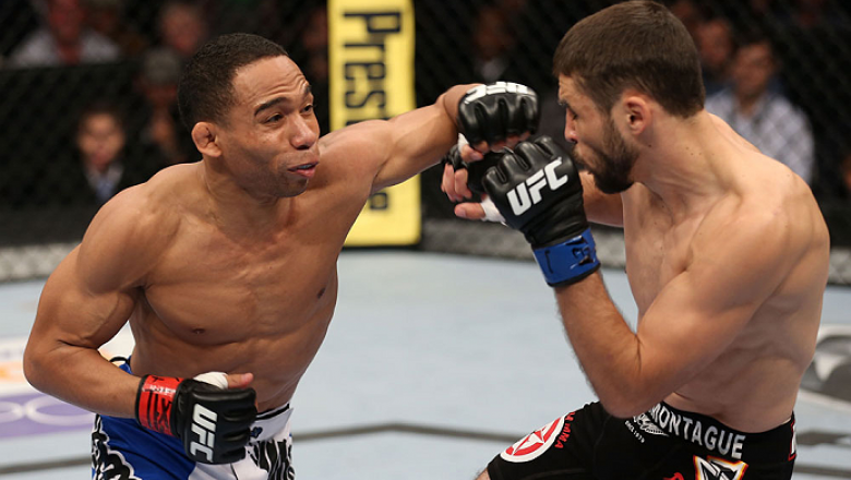 HOUSTON, TEXAS - OCTOBER 19:  (L-R) John Dodson punches Darrell Montague in their UFC flyweight bout at the Toyota Center on October 19, 2013 in Houston, Texas. (Photo by Nick Laham/Zuffa LLC/Zuffa LLC via Getty Images)