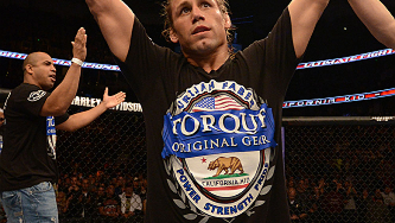 ANAHEIM, CA - FEBRUARY 23:  Urijah Faber is declared the winner over Ivan Menjivar in their bantamweight bout during UFC 157 at Honda Center on February 23, 2013 in Anaheim, California.  (Photo by Donald Miralle/Zuffa LLC/Zuffa LLC via Getty Images) *** L