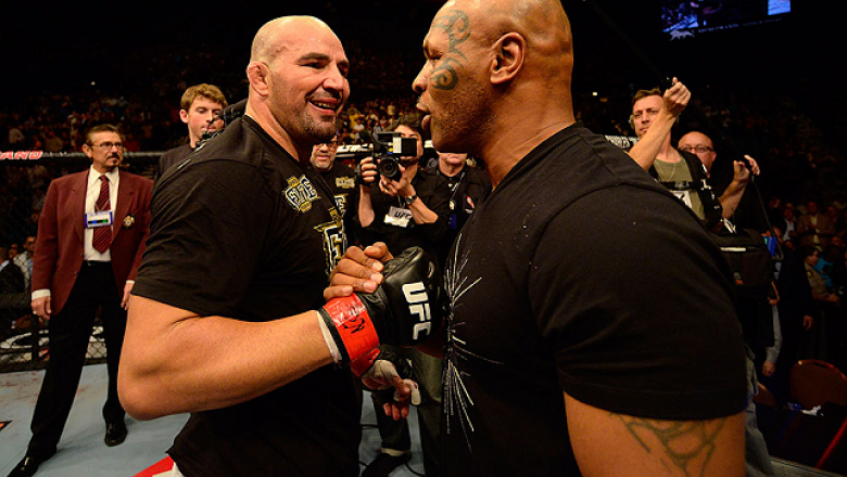 LAS VEGAS, NV - MAY 25:   (R-L) Former professional boxer Mike Tyson congratulates Glover Teixeira in his victory over James Te-Huna in their light heavyweight bout during UFC 160 at the MGM Grand Garden Arena on May 25, 2013 in Las Vegas, Nevada.  (Photo