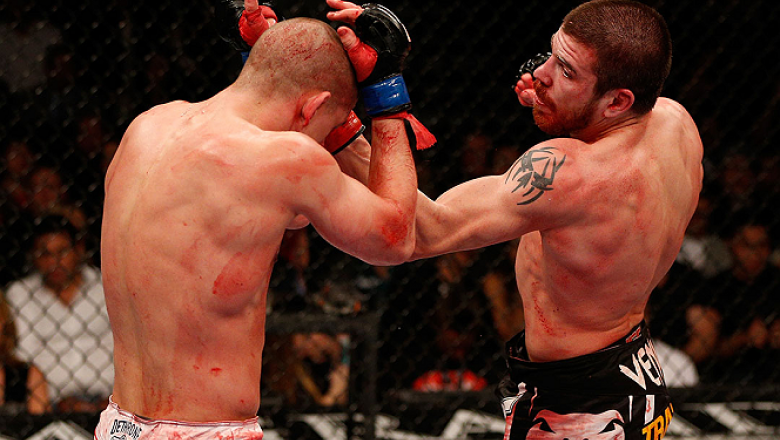 LAS VEGAS, NV - DECEMBER 29:  (R-L) Jim Miller punches Joe Lauzon during their lightweight fight at UFC 155 on December 29, 2012 at MGM Grand Garden Arena in Las Vegas, Nevada. (Photo by Josh Hedges/Zuffa LLC/Zuffa LLC via Getty Images) *** Local Caption