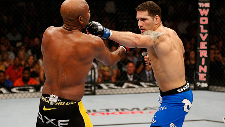 LAS VEGAS, NV - JULY 06:  (R-L) Chris Weidman punches Anderson Silva in their UFC middleweight championship fight during the UFC 162 event inside the MGM Grand Garden Arena on July 6, 2013 in Las Vegas, Nevada.  (Photo by Josh Hedges/Zuffa LLC/Zuffa LLC v
