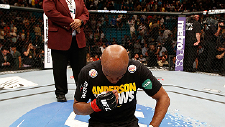 LAS VEGAS, NV - JULY 06:  A dejected Anderson Silva kneels in the Octagon after his loss to Chris Weidman in their UFC middleweight championship fight during the UFC 162 event inside the MGM Grand Garden Arena on July 6, 2013 in Las Vegas, Nevada.  (Photo