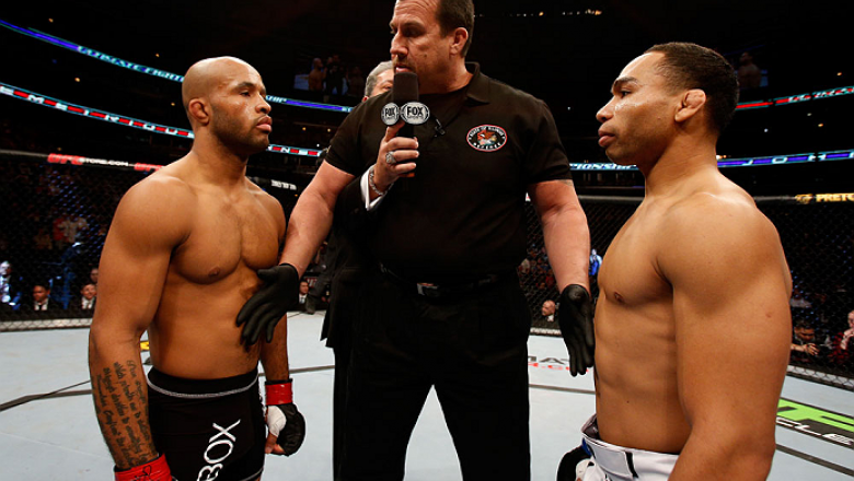 CHICAGO, IL - JANUARY 26:  John Dodson (R) face off with Demetrious Johnson (L) during thier Flyweight Championship Bout part of UFC on FOX at United Center on January 26, 2013 in Chicago, Illinois.  (Photo by Josh Hedges/Zuffa LLC/Zuffa LLC Via Getty Ima