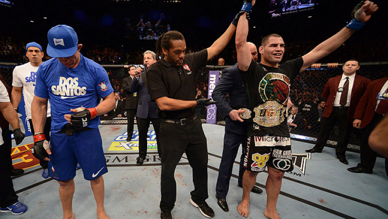 LAS VEGAS, NV - DECEMBER 29:  Cain Velasquez (right) is named the winner over Junior dos Santos (left) after their heavyweight championship fight at UFC 155 on December 29, 2012 at MGM Grand Garden Arena in Las Vegas, Nevada. (Photo by Donald Miralle/Zuff