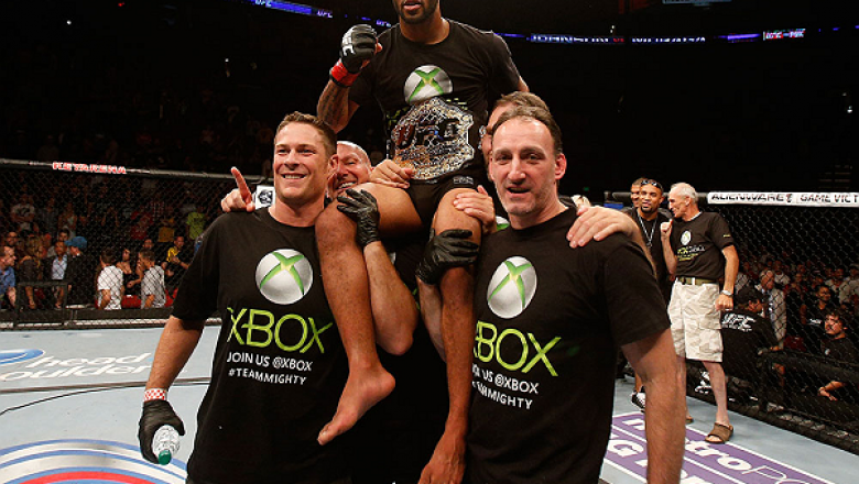 SEATTLE, WA - JULY 27: Demetrious Johnson (top) celebrates to his victory over John Moraga in their flyweight championship bout during the UFC on FOX event at Key Arena on July 27, 2013 in Seattle, Washington. (Photo by Josh Hedges/Zuffa LLC/Zuffa LLC via