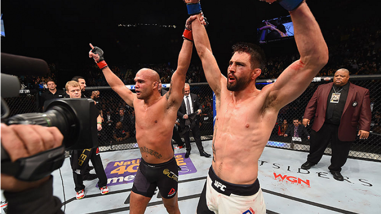 LAS VEGAS, NV - JANUARY 02: Robbie Lawler (left) celebrates with Carlos Condit (right) after their UFC welterweight championship bout during the UFC 195 event inside MGM Grand Garden Arena on January 2, 2016 in Las Vegas, Nevada.  (Photo by Josh Hedges/Zu
