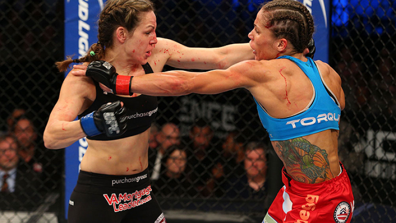 FORT CAMPBELL, KENTUCKY - NOVEMBER 6:  (L-R) Alexis Davis punches Liz Carmouche in their UFC women's bantamweight bout on November 6, 2013 in Fort Campbell, Kentucky. (Photo by Ed Mulholland/Zuffa LLC/Zuffa LLC via Getty Images) *** Local Caption ***Liz C
