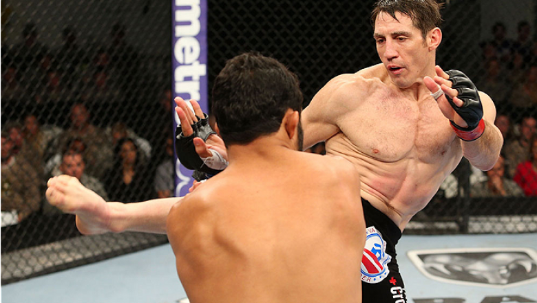 FORT CAMPBELL, KENTUCKY - NOVEMBER 6:  (R-L) Tim Kennedy kicks Rafael Natal in their UFC middleweight bout on November 6, 2013 in Fort Campbell, Kentucky. (Photo by Ed Mulholland/Zuffa LLC/Zuffa LLC via Getty Images) *** Local Caption ***Tim Kennedy; Rafa