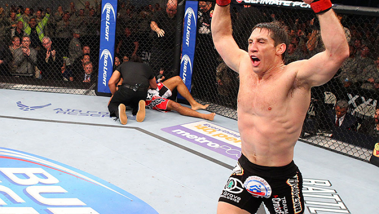 FORT CAMPBELL, KENTUCKY - NOVEMBER 6:  Tim Kennedy (right) reacts to his knockout victory over Rafael Natal in their UFC middleweight bout on November 6, 2013 in Fort Campbell, Kentucky. (Photo by Ed Mulholland/Zuffa LLC/Zuffa LLC via Getty Images) *** Lo