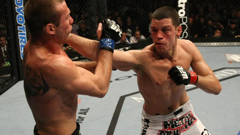 LAS VEGAS, NV - DECEMBER 30:  Nate Diaz (right) punches Donald Cerrone during the UFC 141 event at the MGM Grand Garden Arena on December 30, 2011 in Las Vegas, Nevada.  (Photo by Donald Miralle/Zuffa LLC/Zuffa LLC via Getty Images) *** Local Caption ***