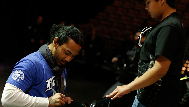 LAS VEGAS, NV - FEBRUARY 01:  UFC lightweight champion Benson Henderson signs an autograph for a young fan during a Q&A session before the UFC 156 weigh-in on February 1, 2013 at Mandalay Bay Events Center in Las Vegas, Nevada.  (Photo by Josh Hedges/Zuff