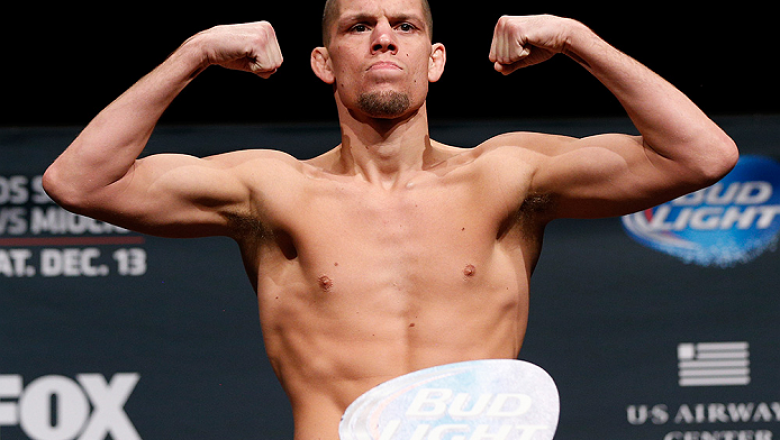 PHOENIX, AZ - DECEMBER 12:  Nate Diaz poses on the scale after missing weight during the UFC Fight Night weigh-in event at the Phoenix Convention Center on December 12, 2014 in Phoenix, Arizona. (Photo by Josh Hedges/Zuffa LLC/Zuffa LLC via Getty Images)