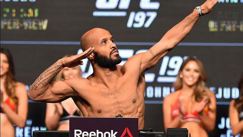 LAS VEGAS, NV - APRIL 20:   UFC flyweight champion Demetrious Johnson steps on the scale during the UFC 197 weigh-in at the MGM Grand Garden Arena on April 20, 2016 in Las Vegas, Nevada. (Photo by Josh Hedges/Zuffa LLC/Zuffa LLC via Getty Images)