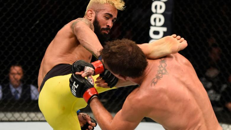 CHICAGO, IL - JULY 23:  (L-R) Godofredo Pepey of Brazil kicks Darren Elkins in their featherweight bout during the UFC Fight Night event at the United Center on July 23, 2016 in Chicago, Illinois. (Photo by Josh Hedges/Zuffa LLC/Zuffa LLC via Getty Images