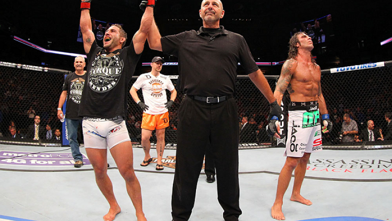 MILWAUKEE, WI - AUGUST 31:  (L-R) Chad Mendes celebrates after defeating Clay Guida in their UFC featherweight bout at BMO Harris Bradley Center on August 31, 2013 in Milwaukee, Wisconsin. (Photo by Ed Mulholland/Zuffa LLC/Zuffa LLC via Getty Images) ***