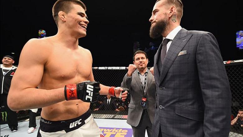 LAS VEGAS, NV - FEBRUARY 06:  (R-L) Phil 'CM Punk' Brooks faces off with Mickey Gall after Gall's victory over Mike Jackson during the UFC Fight Night event at MGM Grand Garden Arena on February 6, 2016 in Las Vegas, Nevada.  (Photo by Jeff Bottari/Zuffa
