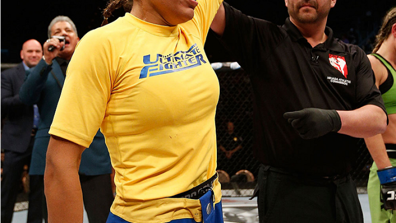 LAS VEGAS, NV - NOVEMBER 30:  Julianna Pena celebrates after defeating Jessica Rakoczy in their women's bantamweight final fight during The Ultimate Fighter season 18 live finale inside the Mandalay Bay Events Center on November 30, 2013 in Las Vegas, Nev