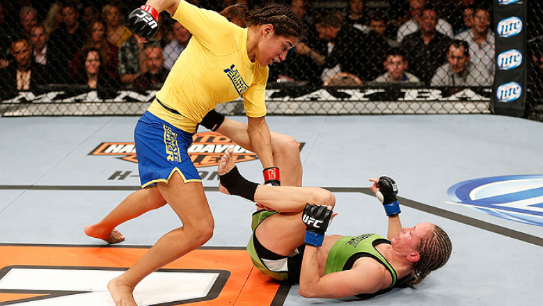 LAS VEGAS, NV - NOVEMBER 30:  (L-R) Julianna Pena punches Jessica Rakoczy in their women's bantamweight final fight during The Ultimate Fighter season 18 live finale inside the Mandalay Bay Events Center on November 30, 2013 in Las Vegas, Nevada. (Photo b