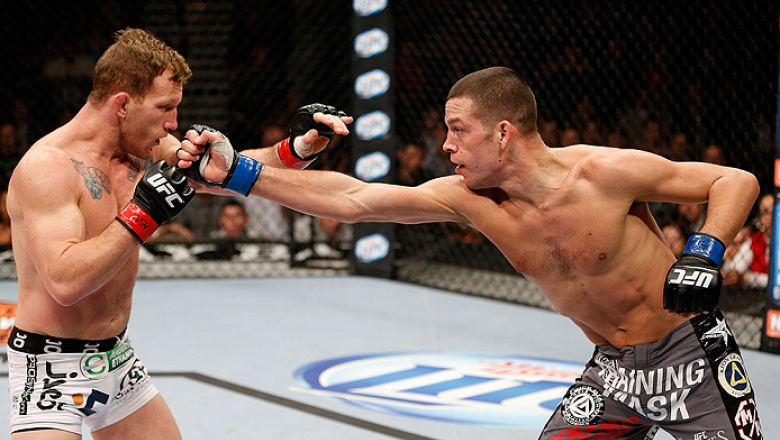LAS VEGAS, NV - NOVEMBER 30:  (R-L) Nate Diaz punches Gray Maynard in their lightweight fight during The Ultimate Fighter season 18 live finale inside the Mandalay Bay Events Center on November 30, 2013 in Las Vegas, Nevada. (Photo by Josh Hedges/Zuffa LL