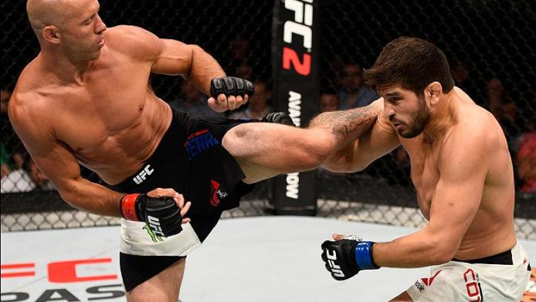 OTTAWA, ON - JUNE 18:   (L-R) Donald Cerrone of the United States kicks Patrick Cote of Canada in their welterweight bout during the UFC Fight Night event inside the TD Place Arena on June 18, 2016 in Ottawa, Ontario, Canada. (Photo by Jeff Bottari/Zuffa