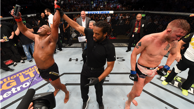 HOUSTON, TX - OCTOBER 03:  (L-R) Daniel Cormier celebrates his victory over Alexander Gustafsson in their UFC light heavyweight championship bout during the UFC 192 event at the Toyota Center on October 3, 2015 in Houston, Texas. (Photo by Josh Hedges/Zuf