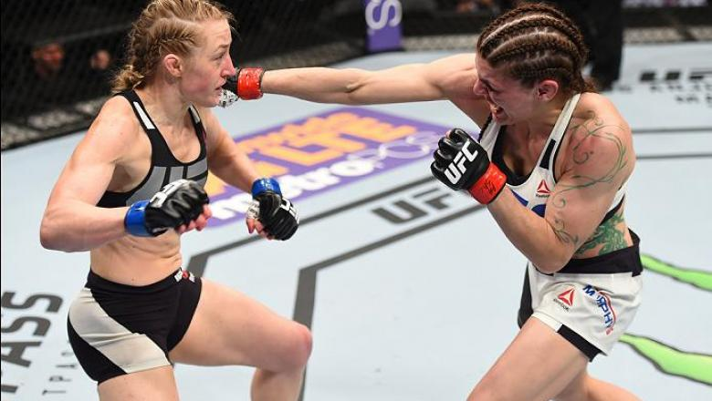 PITTSBURGH, PA - FEBRUARY 21:  (R-L) Lauren Murphy punches Kelly Faszholz in their women's bantamweight bout during the UFC Fight Night event at Consol Energy Center on February 21, 2016 in Pittsburgh, Pennsylvania. (Photo by Jeff Bottari/Zuffa LLC/Zuffa