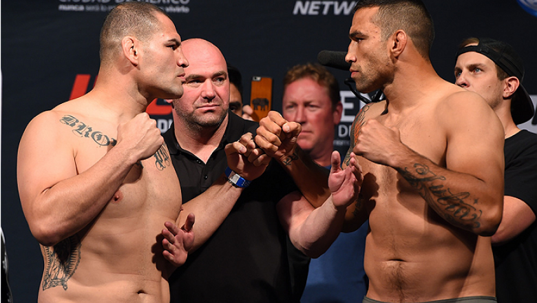 MEXICO CITY, MEXICO - JUNE 12:  (L-R) Cain Velasquez of the United States and Fabricio Werdum of Brazil face off during the UFC 188 weigh-in inside the Arena Ciudad de Mexico on June 12, 2015 in Mexico City, Mexico. (Photo by Josh Hedges/Zuffa LLC/Zuffa L