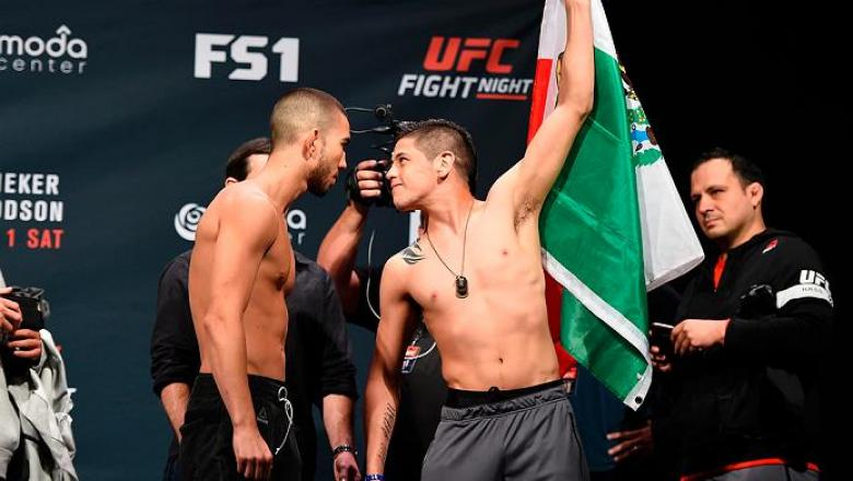 PORTLAND, OR - SEPTEMBER 30:  (L-R) Louis Smolka and Brandon Moreno of Mexico face-off during the UFC Fight Night weigh-in at the Oregon Convention Center on September 30, 2016 in Portland, Oregon. (Photo by Josh Hedges/Zuffa LLC/Zuffa LLC via Getty Image