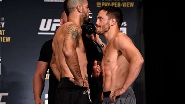 ATLANTA, GA - JULY 29:  (L-R) Opponents Matt Brown and Jake Ellenberger face off during the UFC 201 weigh-in at Fox Theatre on July 29, 2016 in Atlanta, Georgia. (Photo by Jeff Bottari/Zuffa LLC/Zuffa LLC via Getty Images)