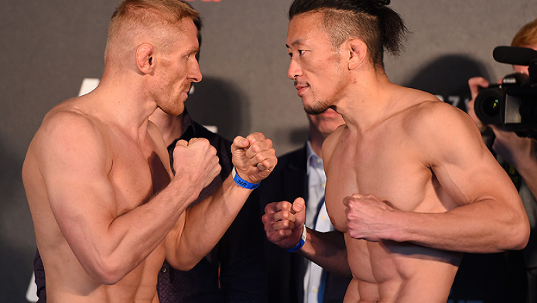 BERLIN, GERMANY - JUNE 19:   (L-R) Opponents Dennis Siver of Germany and Tatsuya Kawajiri of Japan face off during the UFC Berlin weigh-in at the O2 World on June 19, 2015 in Berlin, Germany. (Photo by Josh Hedges/Zuffa LLC/Zuffa LLC via Getty Images)