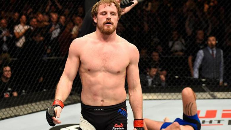 LONDON, ENGLAND - MARCH 18:  (L-R)Gunnar Nelson of Iceland celebrates his submission victory over Alan Jouban of the United States in their welterweight fight during the UFC Fight Night event at The O2 arena on March 18, 2017 in London, England. (Photo by