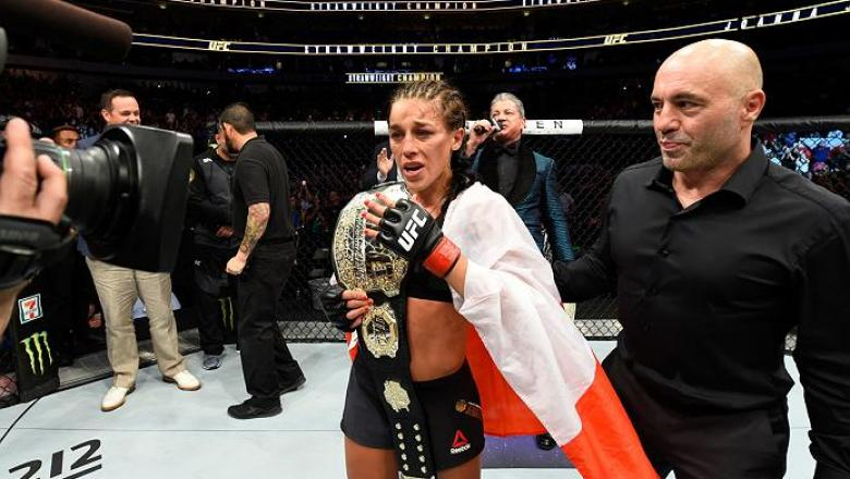 DALLAS, TX - MAY 13:  Joanna Jedrzejczyk celebrates her victory over Jessica Andrade in their UFC women's strawweight championship fight during the UFC 211 event at the American Airlines Center on May 13, 2017 in Dallas, Texas. (Photo by Josh Hedges/Zuffa