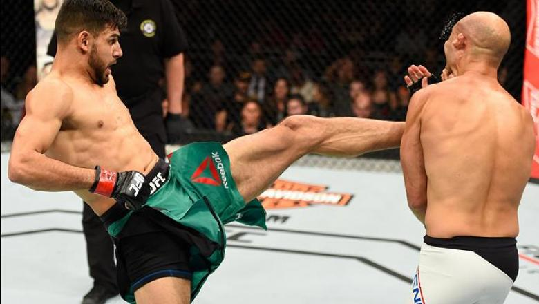 PHOENIX, AZ - JANUARY 15:  (L-R) Yair Rodriguez of Mexico kicks BJ Penn in their featherweight bout during the UFC Fight Night event inside Talking Stick Resort Arena on January 15, 2017 in Phoenix, Arizona. (Photo by Jeff Bottari/Zuffa LLC/Zuffa LLC via