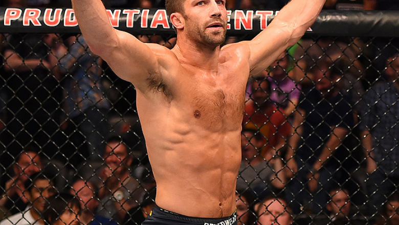 NEWARK, NJ - APRIL 18:  Luke Rockhold celebrates defeating Lyoto Machida of Brazil by tap out in their middleweight bout during the UFC Fight Night event at Prudential Center on April 18, 2015 in Newark, New Jersey.  (Photo by Josh Hedges/Zuffa LLC/Zuffa