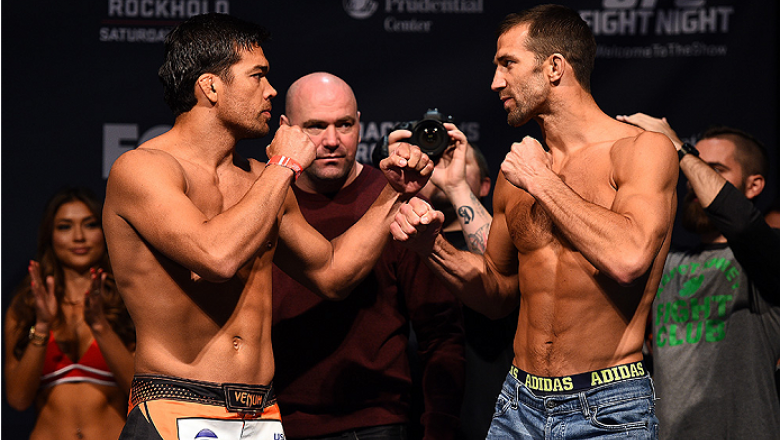 NEWARK, NJ - APRIL 17:  (L-R) Lyoto 'The Dragon' Machida of Brazil and Luke Rockhold face off during the UFC Fight Night weigh-in event at the Prudential Center on April 17, 2015 in Newark, New Jersey. (Photo by Jeff Bottari/Zuffa LLC/Zuffa LLC via Getty