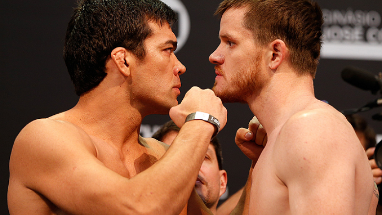 BARUERI, BRAZIL - DECEMBER 19:  (L-R) Opponents Lyoto Machida of Brazil and CB Dollaway of the United States face off during the UFC weigh-in event inside the Ginasio Jose Correa on December 19, 2014 in Barueri, Brazil. (Photo by Josh Hedges/Zuffa LLC/Zuf