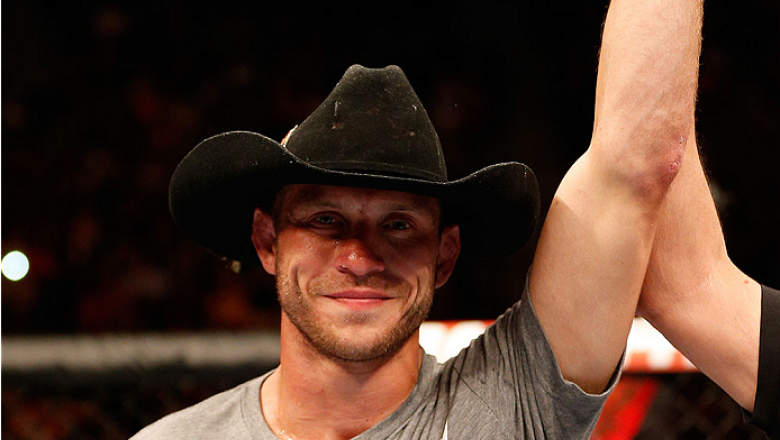 """ORLANDO, FL - APRIL 19:  Donald """"Cowboy"""" Cerrone reacts after his submission victory over Edson Barboza in their lightweight bout during the FOX UFC Saturday event at the Amway Center on April 19, 2014 in Orlando, Florida. (Photo by Josh Hedges/Zuffa LLC/"""