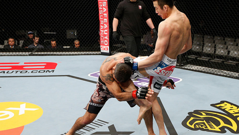 SAITAMA, JAPAN - MARCH 03:  (R-L) Hyun Gyu Lim knees Marcelo Guimaraes in their welterweight fight during the UFC on FUEL TV event at Saitama Super Arena on March 3, 2013 in Saitama, Japan.  (Photo by Josh Hedges/Zuffa LLC/Zuffa LLC via Getty Images)