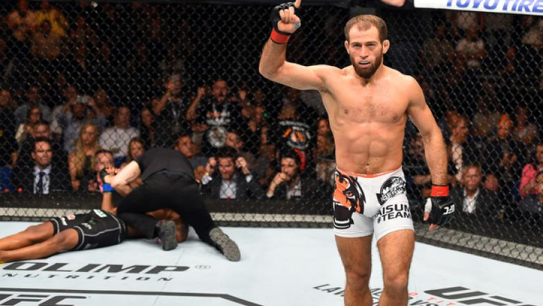 BERLIN, GERMANY - JUNE 20:  (R-L) Mairbek Taisumov of Russia celebrates after defeating Alan Patrick of Brazil in their lightweight bout during the UFC Fight Night event at the O2 World on June 20, 2015 in Berlin, Germany. (Photo by Josh Hedges/Zuffa LLC/