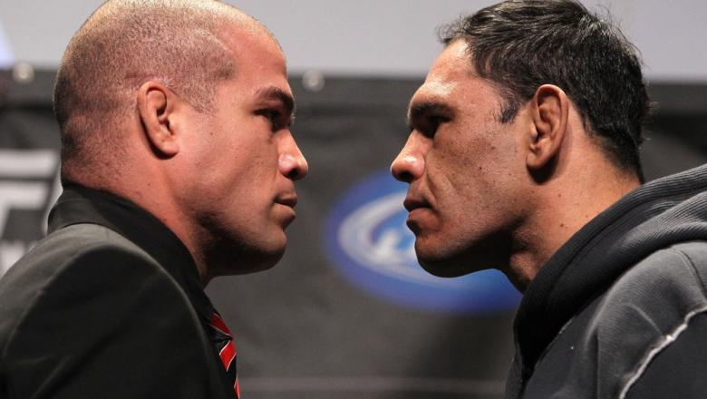 "TORONTO, ON - DECEMBER 08:  (L-R) Light Heavyweight opponents Tito Ortiz and Antonio Rogerio ""Minotoro"" Nogueira face off at the final UFC 140 pre-fight press conference at Bell Tiff Lightbox Cinema1 on December 8, 2011 in Toronto, Canada.  (Photo by Josh"
