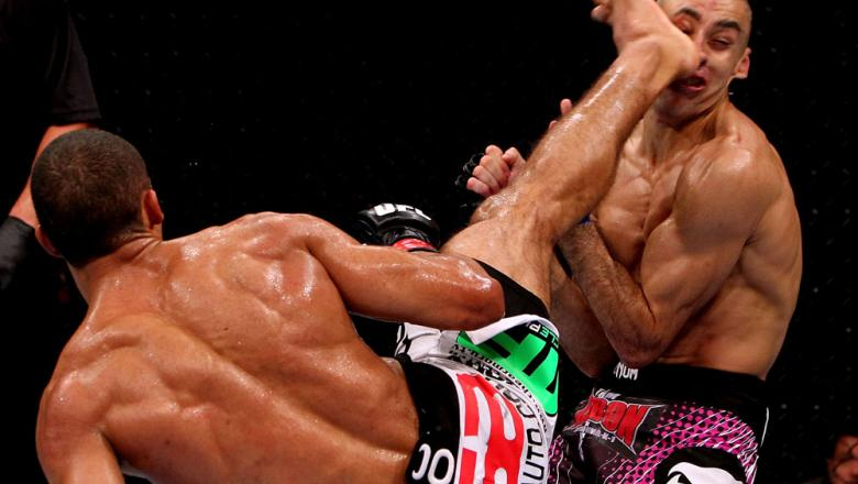 RIO DE JANEIRO, BRAZIL - JANUARY 14:  Edson Barboza (L) knocks out Terry Etim (R) with a spinning back kick in a lightweight bout during UFC 142 at HSBC Arena on January 14, 2012 in Rio de Janeiro, Brazil.  (Photo by Josh Hedges/Zuffa LLC/Zuffa LLC via Ge