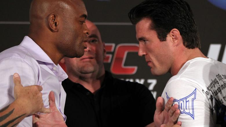 LAS VEGAS, NV - JULY 3:   (L-R) Opponents Anderson Silva and Chael Sonnen are separated by UFC President Dana White during the UFC 148 press conference at Lagasse's Stadium inside The Palazzo on July 3, 2012 in Las Vegas, Nevada.  (Photo by Josh Hedges/Zu