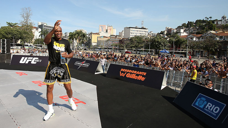 RIO DE JANEIRO, BRAZIL - OCTOBER 10:  Anderson Silva greets fans after an open training session ahead of UFC 153 at Arcos da Lapa: Praca Cardeal Camara on October 10, 2012 in Rio de Janeiro, Brazil.  (Photo by Josh Hedges/Zuffa LLC/Zuffa LLC via Getty Ima