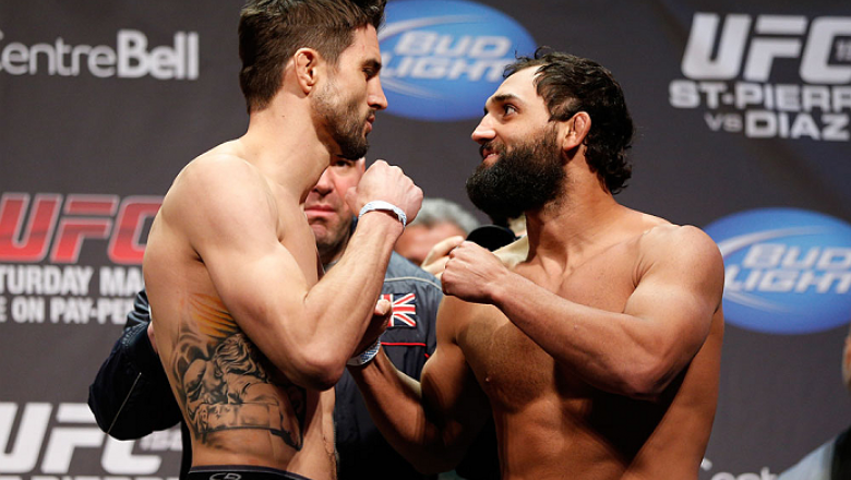 MONTREAL, QC - MARCH 15: Carlos Condit and Johny Hendricks face off during the UFC 158 weigh-in at Bell Centre on March 15, 2013 in Montreal, Quebec, Canada.  (Photo by Josh Hedges/Zuffa LLC/Zuffa LLC via Getty Images)